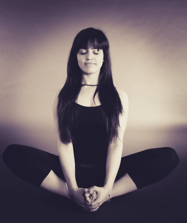 Young woman in a yoga meditation post