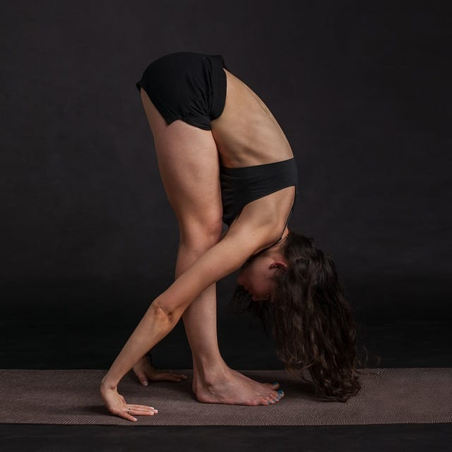 Woman bending forward at the waist in a yoga pose